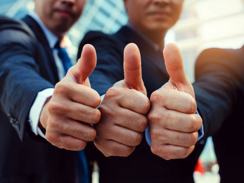 Great. close up of hand group of handsome business people team in suit showing thumbs up as like sign together in city, successful, support, meeting, partner, teamwork, community, connection concept